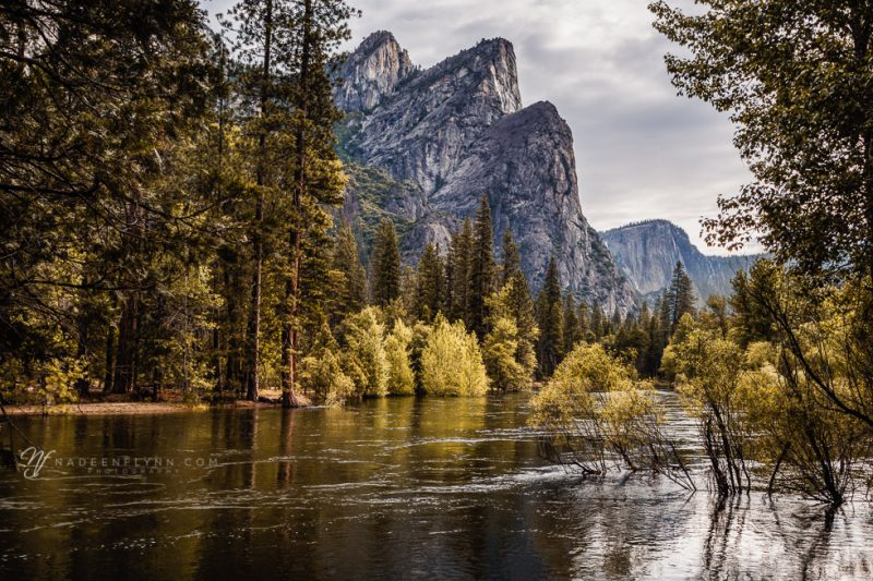 Three Brothers rock formation in Yosemite Valley along the Merced River