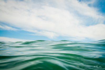 An ocean wave meets blue sky.