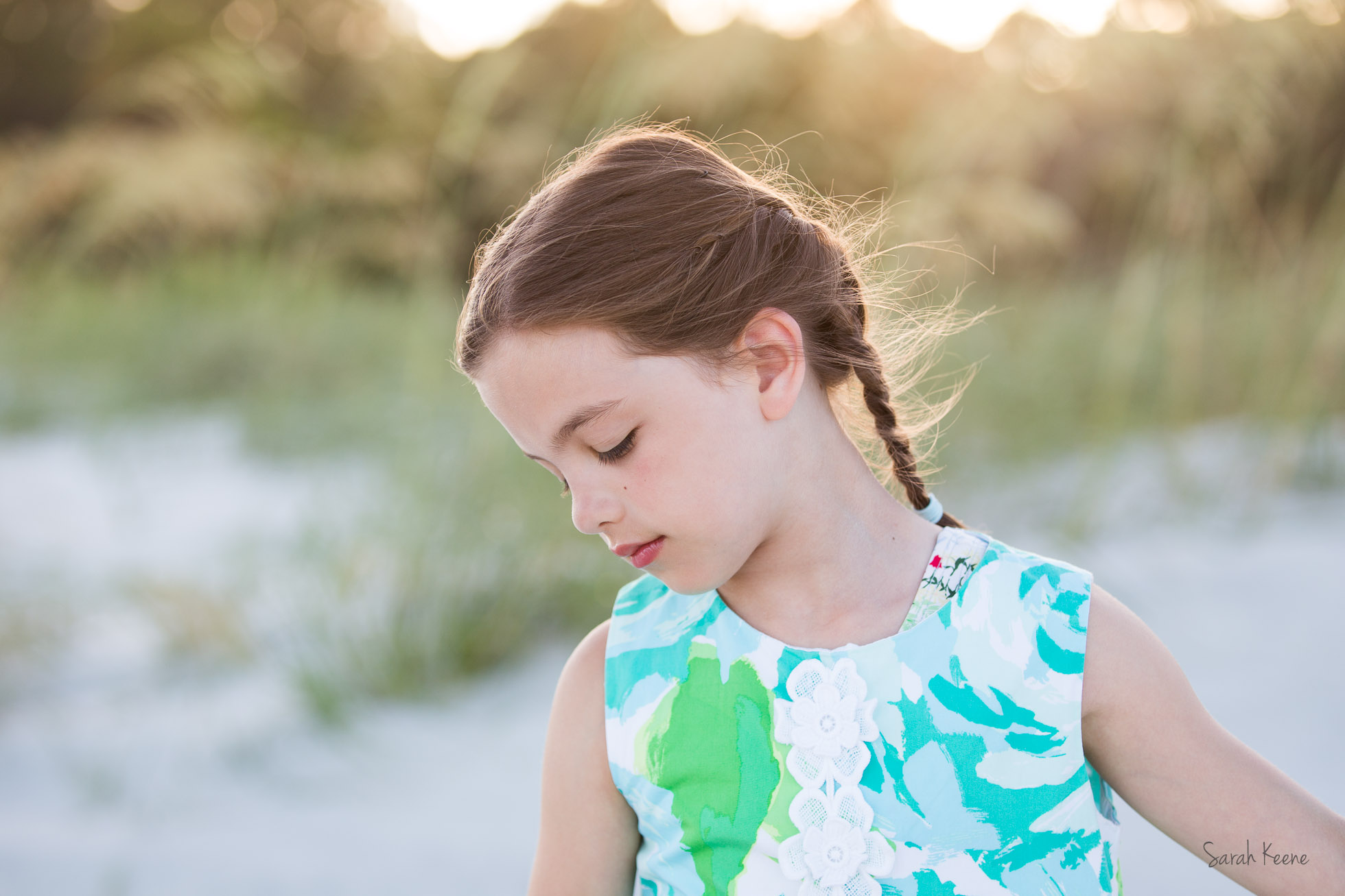 Beautiful wisps of hair lit up in a beach portrait.