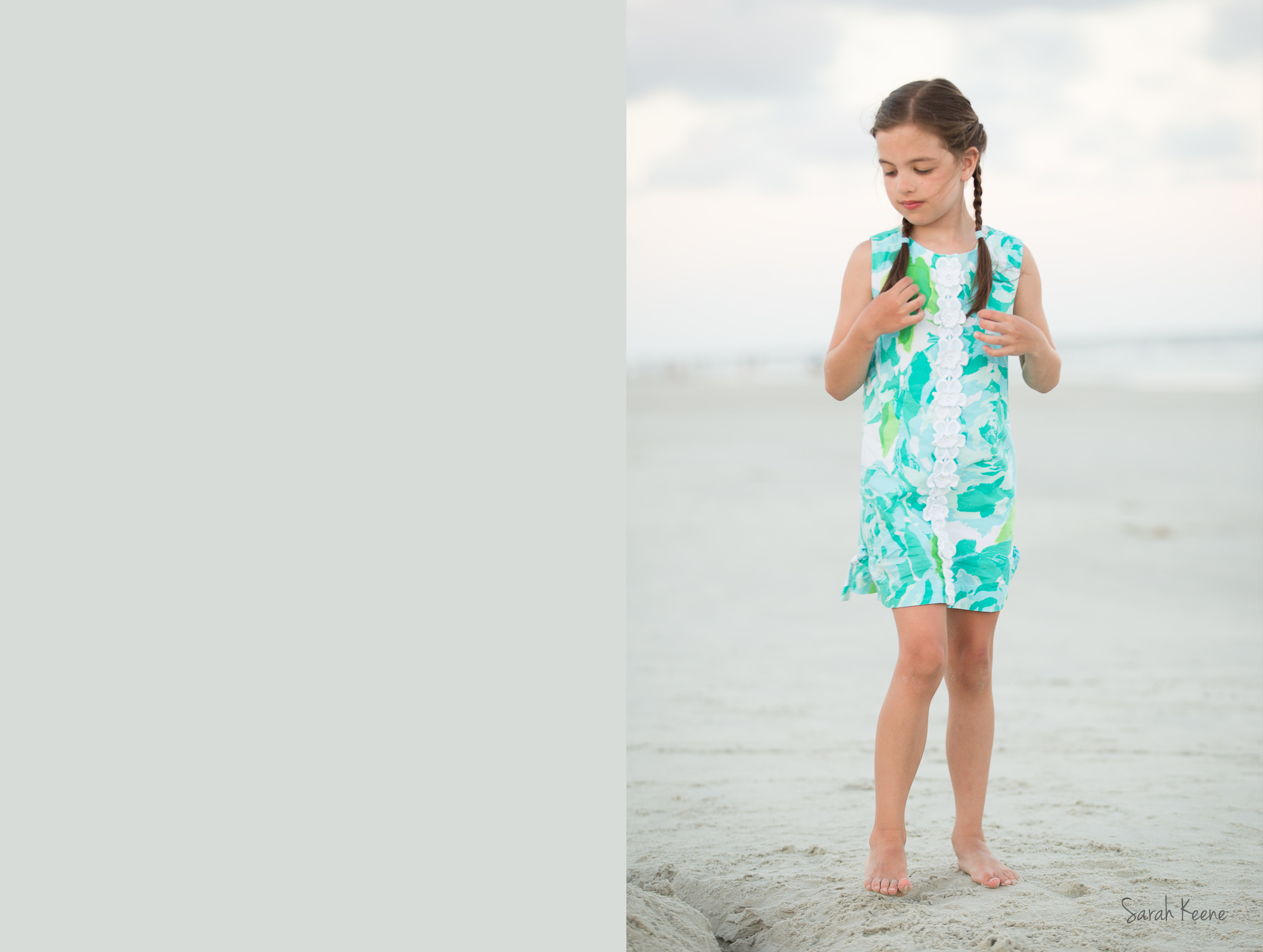 A portrait of ayoung girl with braids at the beach