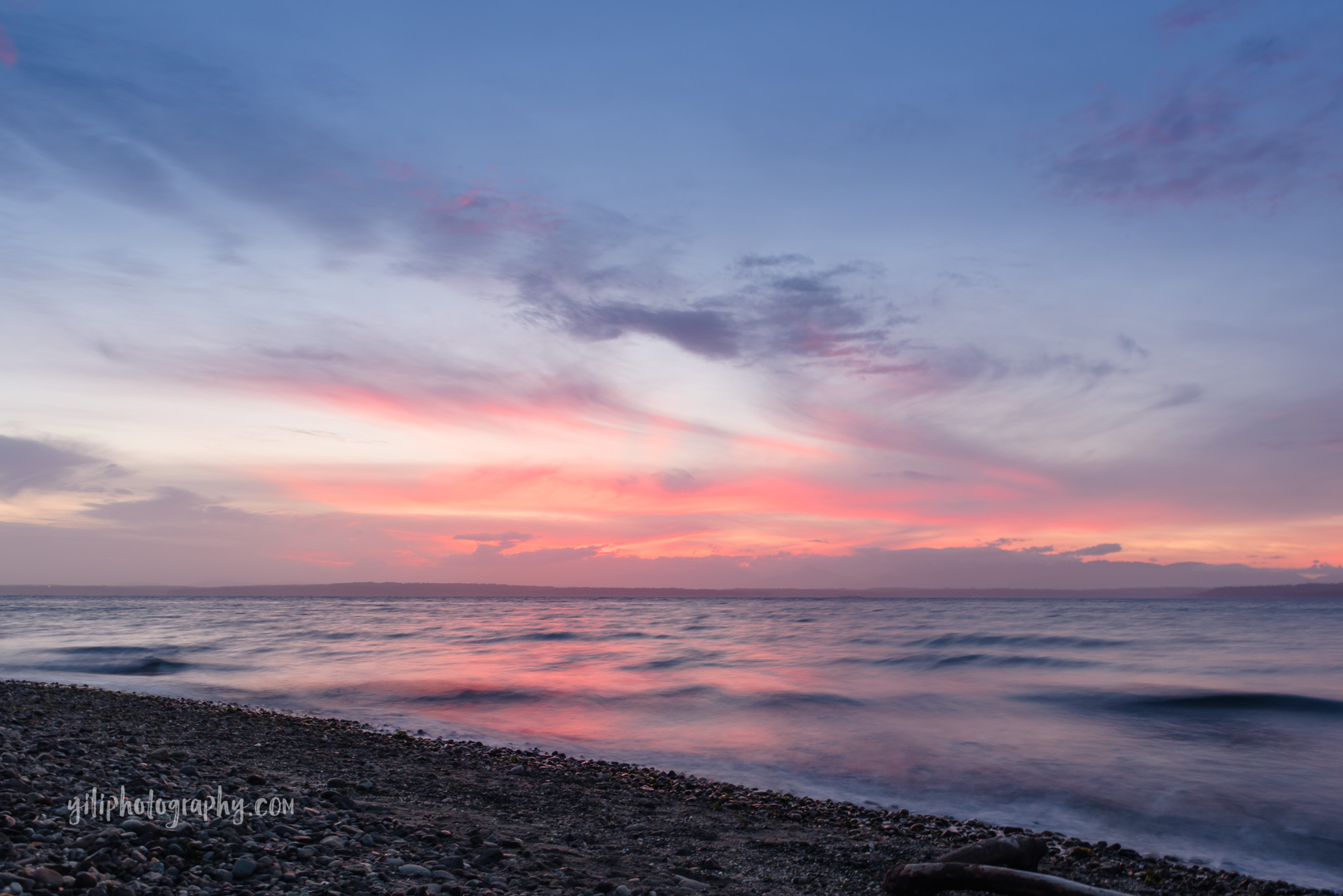 Carkeek beach in Seattle at sunset with blue pink sky