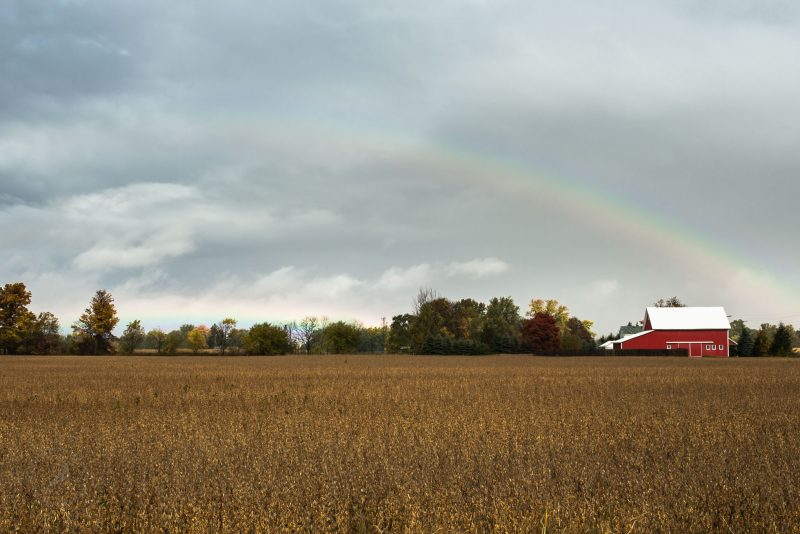 double rainbow following a brief downpour is seen over a red barn and field outside of Nappanee, Indiana