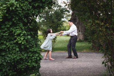 A father dances with his 8 year-old daughter while taking a break during a photo shoot at The Carriage House in South Bend, IN.