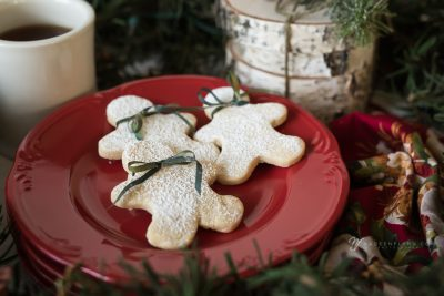Frosty snowman sugar cookies on a red plate