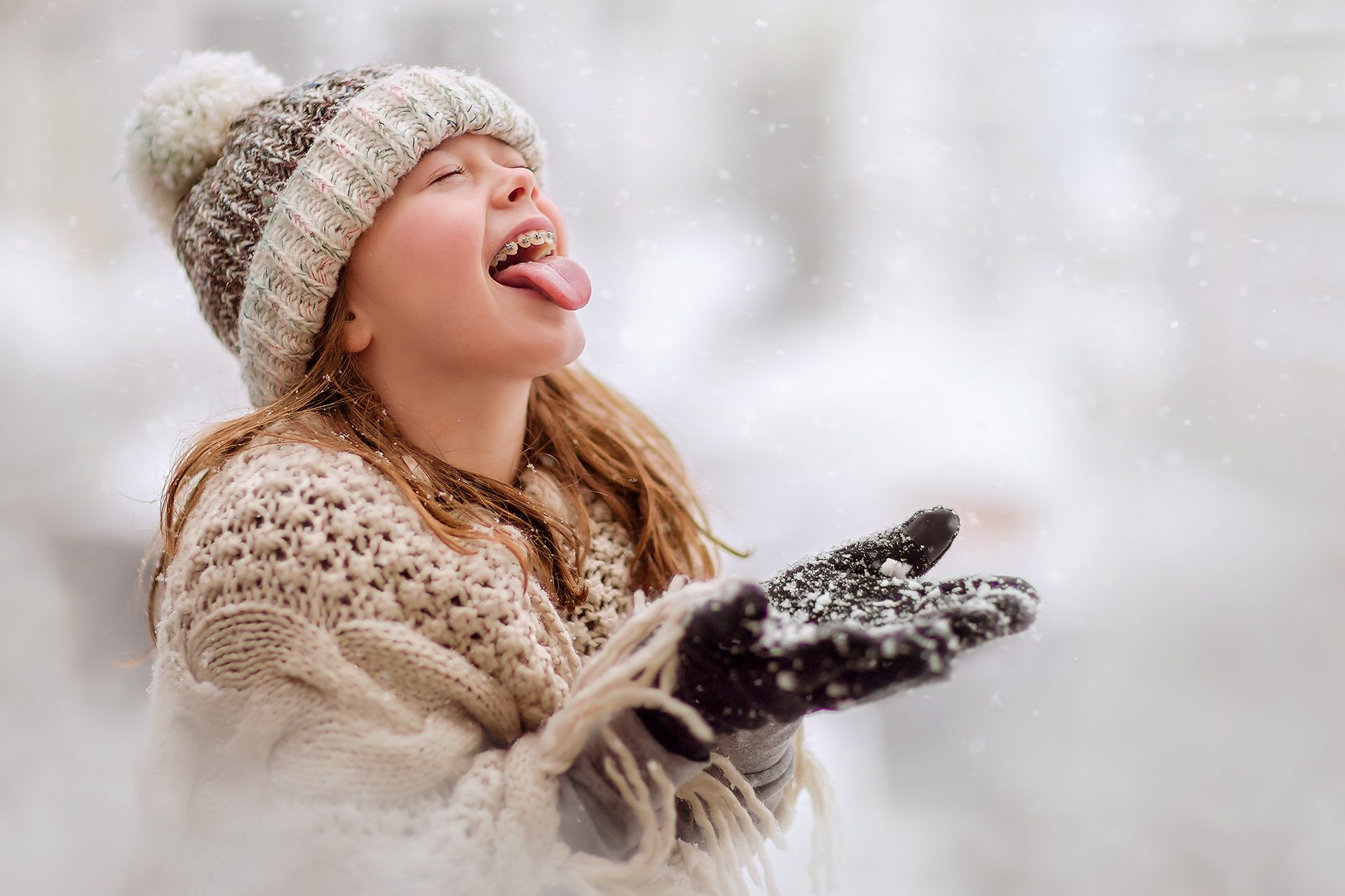 Portrait of a girl eating snow by Willie Kers