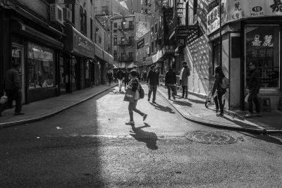 Susan-Bahen-Photography-Ottawa-fine-art-photographer-woman-shopping-chinatown-new-york-city-shadows