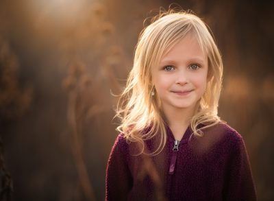 growing up blonde girl in field edmond ok photographer oklahoma city natural light photographer kate luber photography