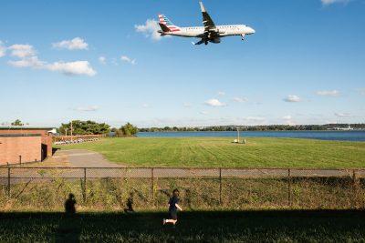 Child chasing plane in sky