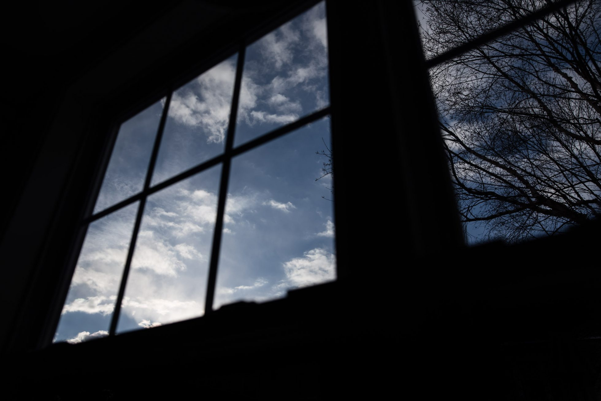 Silhouette of window with blue sky and clouds photograph by megan cieloha