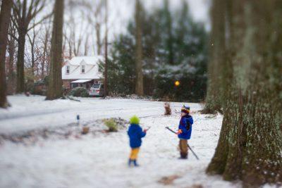 boys playing in the snowy yard