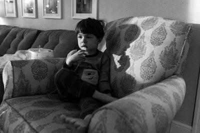 boy taking breathing medicine