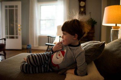boy on couch with static electricity