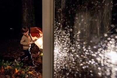 boy with umbrella on rainy night