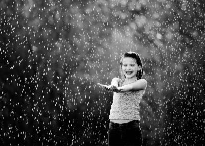 girl playing in the rain