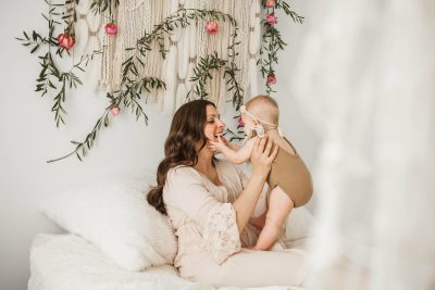Mommy and me session with bohemian and floral setup in Cleveland Ohio by top Akron photographer Chelsey Hill Photography