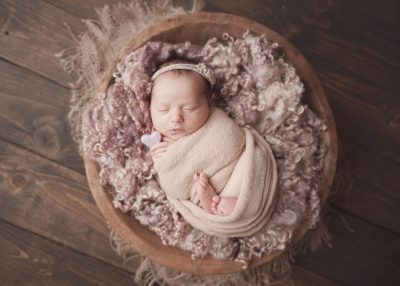 Posed baby in bucket with fluff using studio lighting by top newborn photographer Chelsey Hill Photography