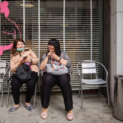 two_friends_sitting_outside_in_taiwan_Street_Photography_by_Rebecca_Hunnicutt_Farren