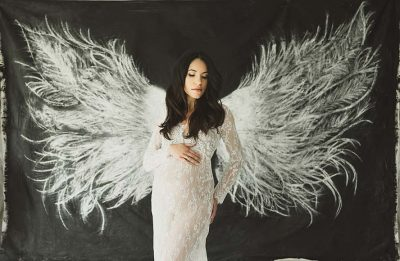 expecting mother with wings