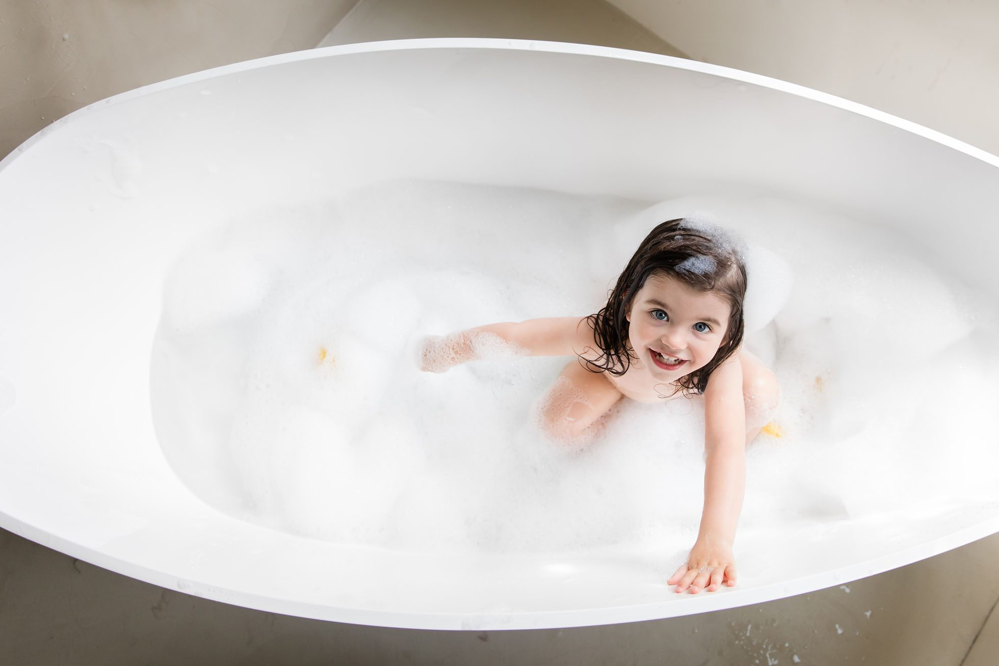 Little girl, big bath
