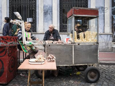 Photo of elderly couple selling snacks from a food cart in San Telmo Buenos Aires