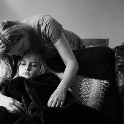 black_and_white_self_portrait_with_sick_child   sick day_click-Pro_daily_project_by Eileen Critchley