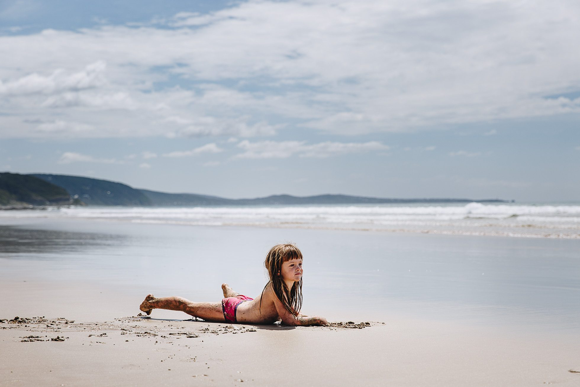 young girl without clothes on the Australian beach