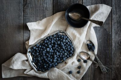 blueberries on linen with vintage spoons