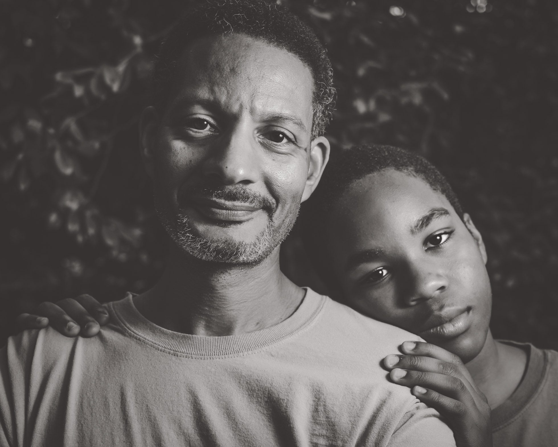 African American Father standing with son