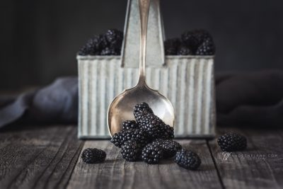 blackberries with vintage spoon and carrier still life
