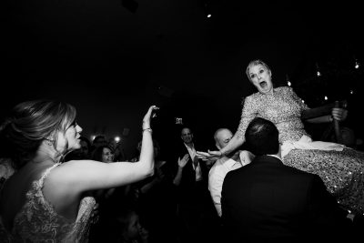 Mom is scared during hora dance at wedding photojournalist wedding