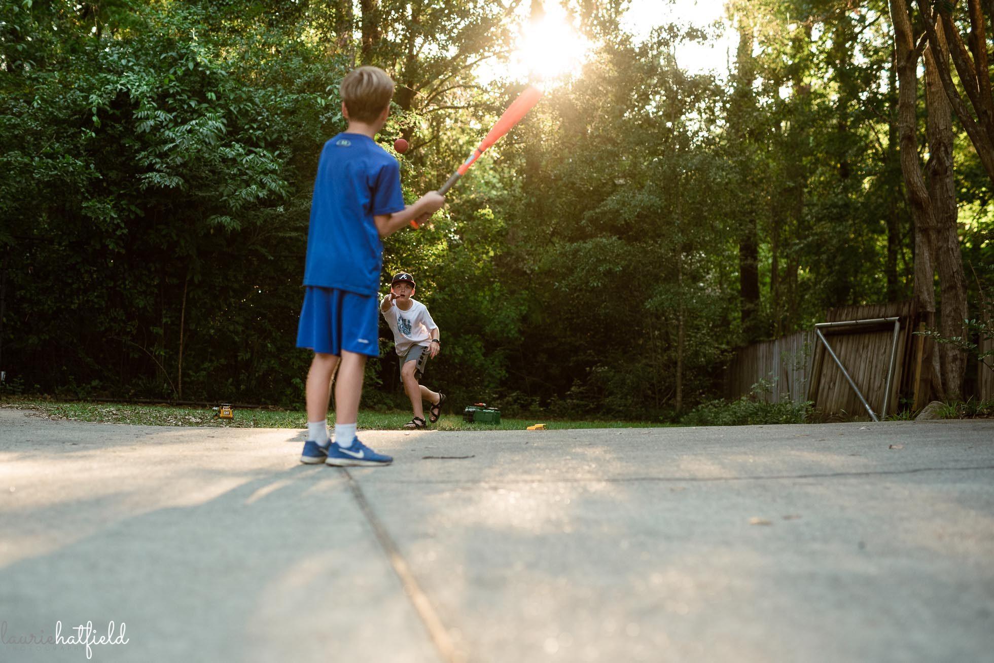 two brothers playing baseball