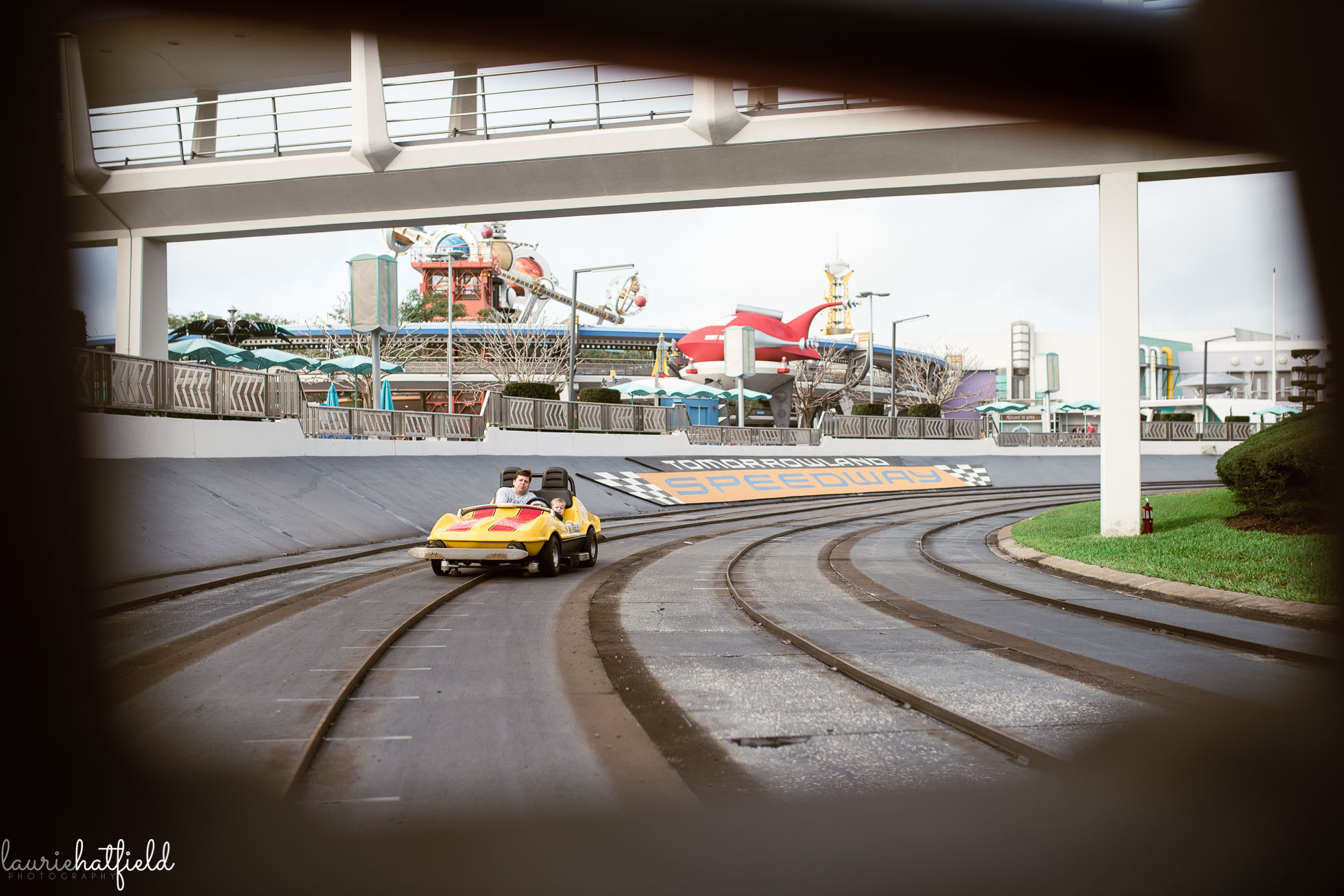 dad and son on Tomorrowland Speedway at Disney World