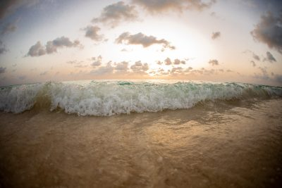 Waves crashing on the shore at the beach in Grand Cayman