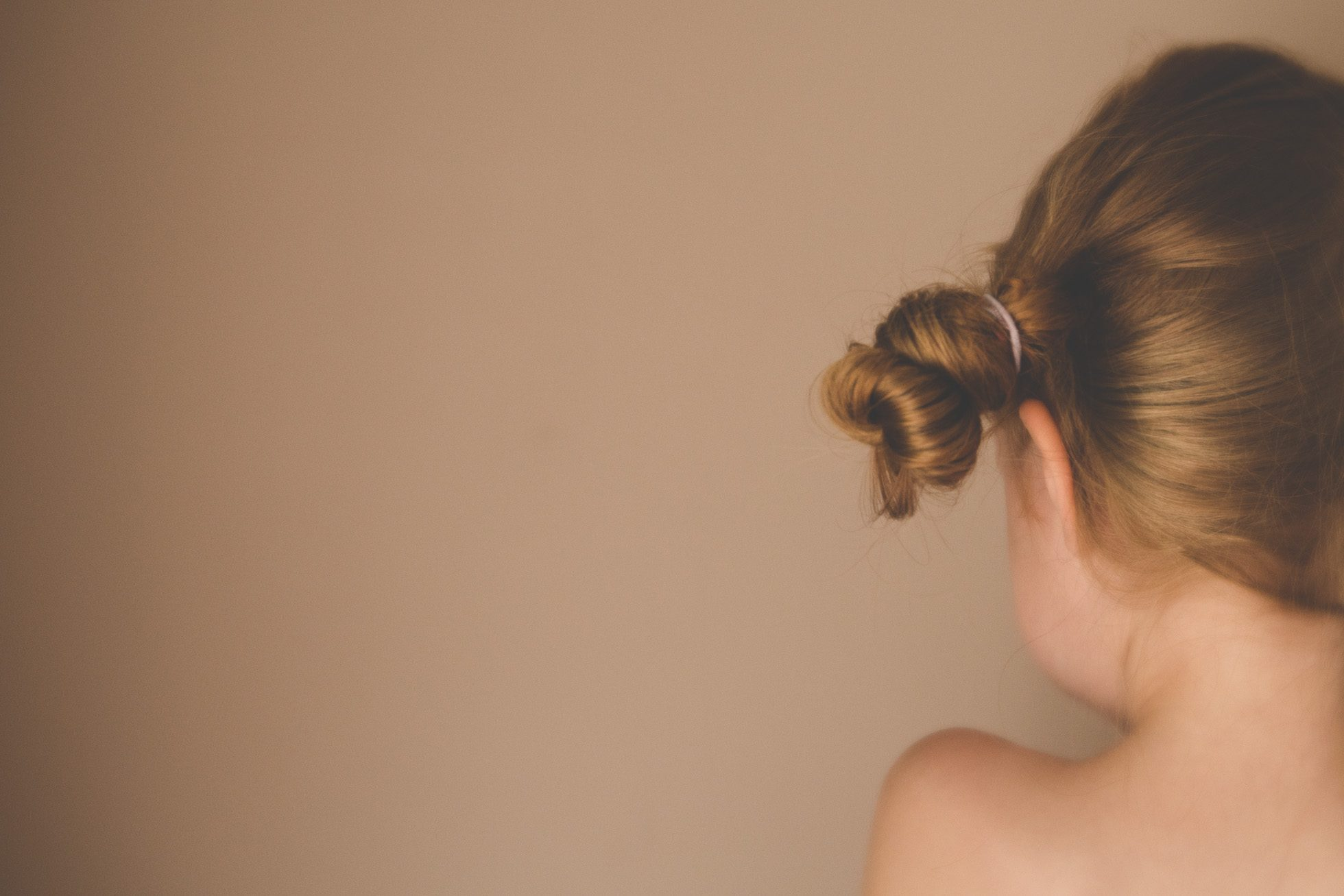 tiny pigtail bun on little girl by tiffany kelly