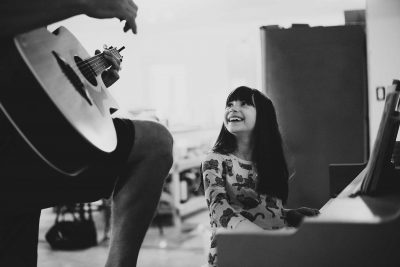 Daddy and daughter playing piano and guitar together in black and white