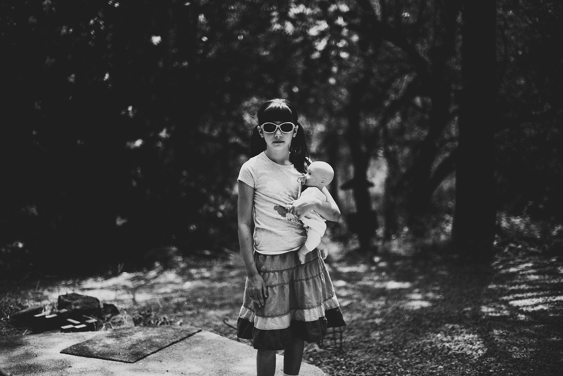 black and white little girl and her baby doll