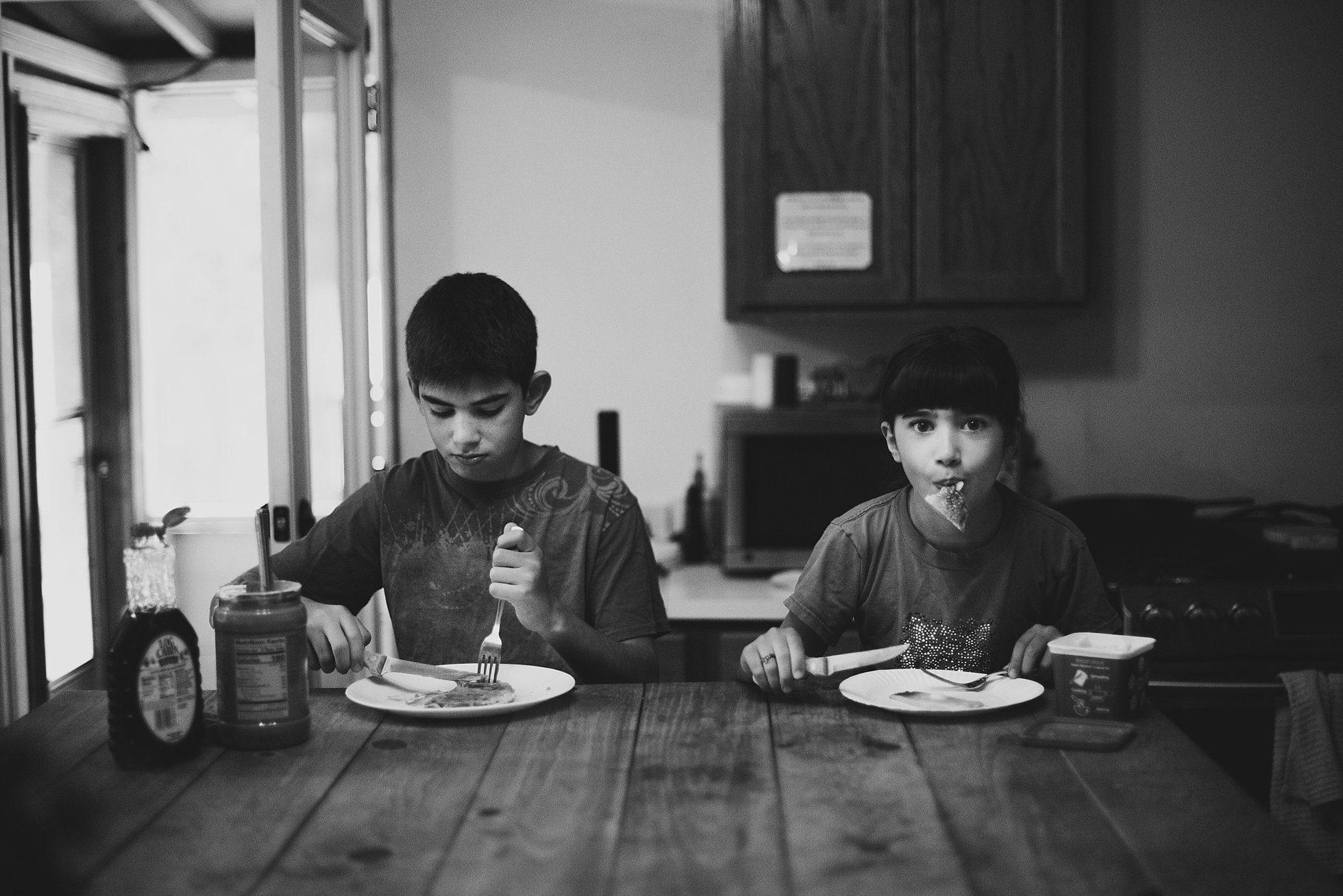 black and white kids eating pancakes