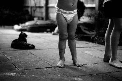 Bare legs black and white child Amersham Buckinghamshire photographer