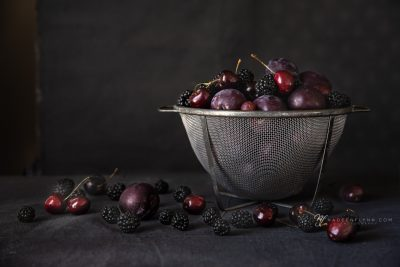 black fruit in a vintage mesh container for life exposed workshop