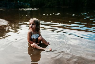 Toddler playing in lake in Hot Springs, Arkansas