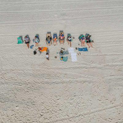 friends on beach, overhead shot by DJI Spark drone
