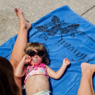 baby girl at pool, sunglasses on baby, little girl