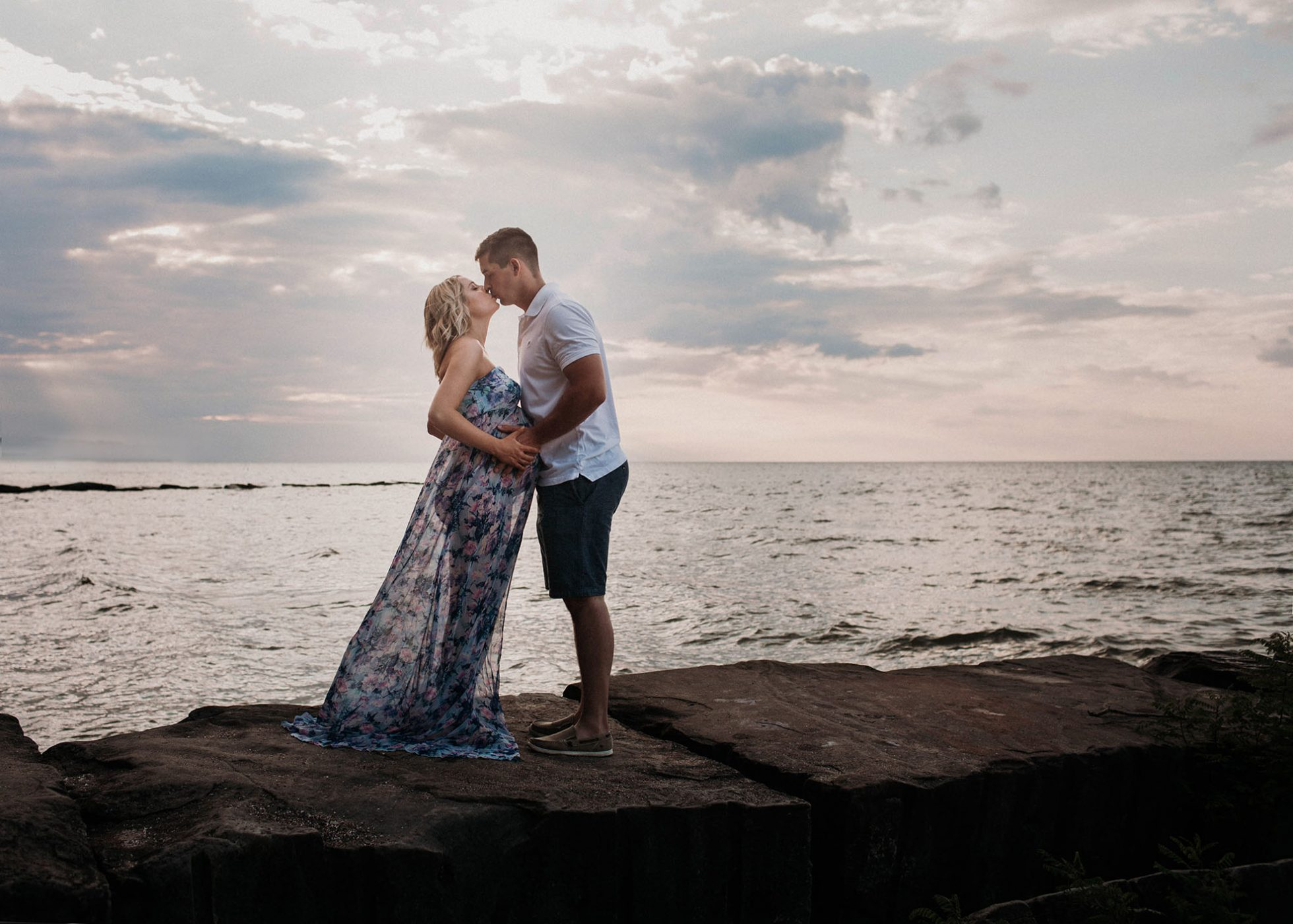 Cleveland maternity photographer posing couple on Lake Erie with sunset by Chelsey Hill Photography