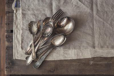 a collection of vintage spoons on linen for life exposed photography retreat