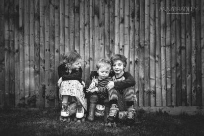 Three siblings black and white Amersham Buckinghamshire family photographer