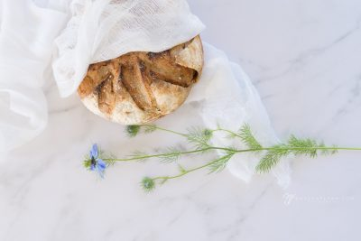 bread and blue flowers still life photo life exposed