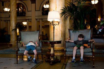 boys wait in fancy chairs at willard hotel in washington DC