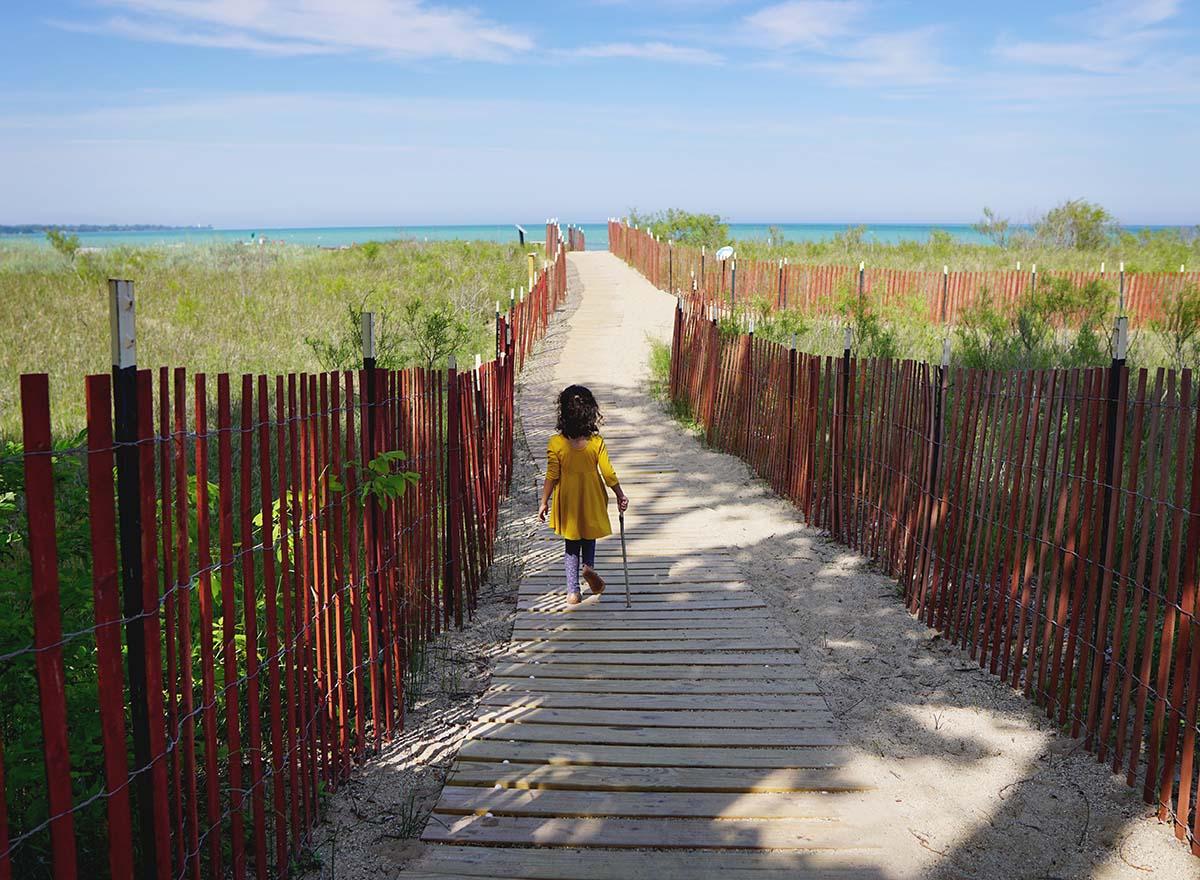 Little girl walking towards Lake Michigan