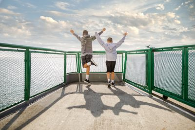 Boys Jumping on Ferry By Shelly Niehaus Photography