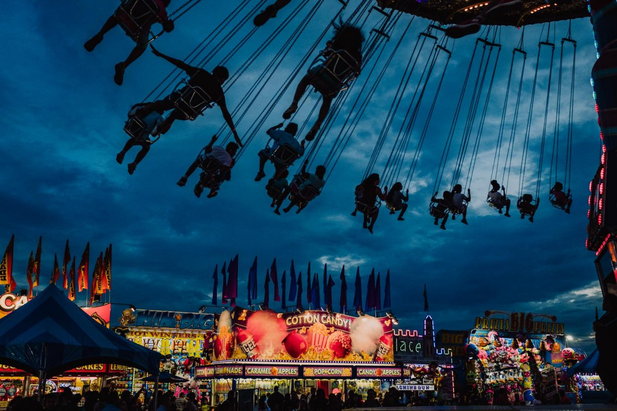 People ride the swings at a carnival